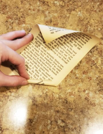 Tear out 12 pages from your old book. Roll each page starting from the bottom right corner to the top left corner.