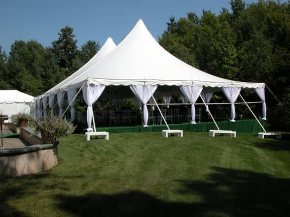 This pole tent with a subfloor has pole drapes, which I like because they're decorative but not fussy and cost-effective.