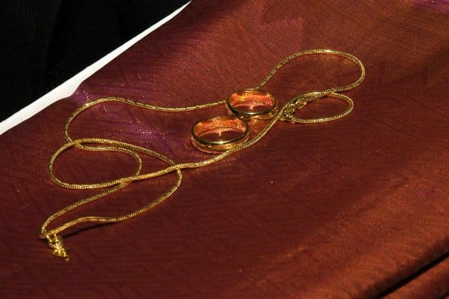 The Thali or Mangalsutra and the rings.
