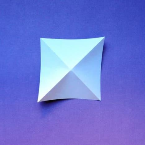 Fold a square two ways diagonally.