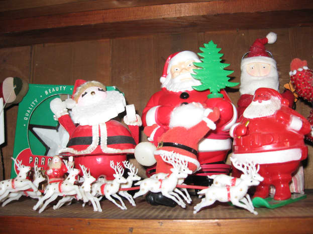Vintage plastic Santas from the 1950s.