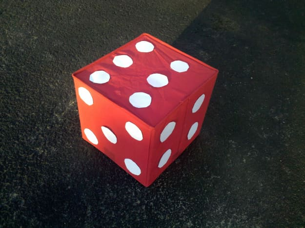 Our die made from an old storage bin and circles cut out of construction paper.