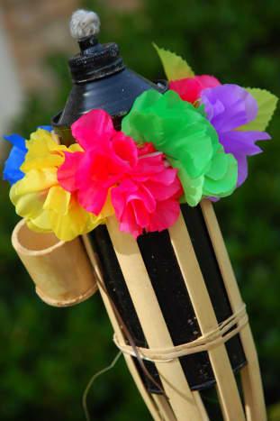 Use leis to decorate tiki torches.