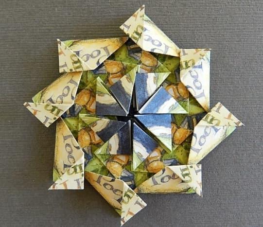 Make half kite folds on tips of the outsde folds.  Make half kites on the inside folds.