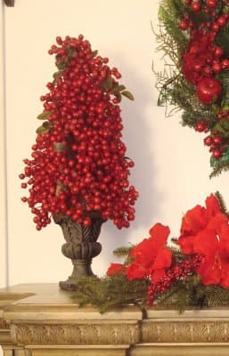 A Red Berry Christmas topiary adds color and elegance to your decor.