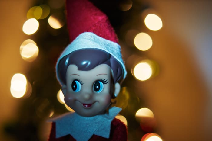 Elves are often depicted in red or green suits and pointed hats.