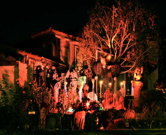 Decorating the house for Halloween is a fun and spooky activity.