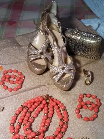 The gold shoes and matching clutch.