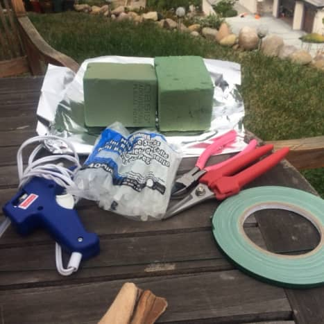Essentials for the project: oasis, hot glue gun, floral tape, floral scissors, glue sticks, aluminium foil.