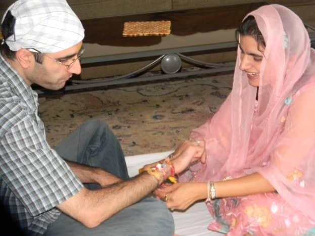 Tying the rakhi.