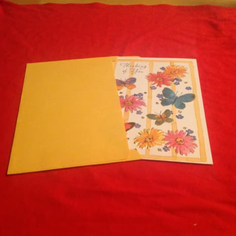This is the right way to put a folded greeting card in its envelope.