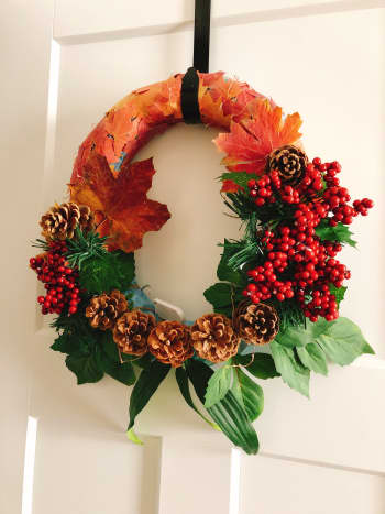I wanted this handmade holiday wreath to incorporate both fall and winter motifs.