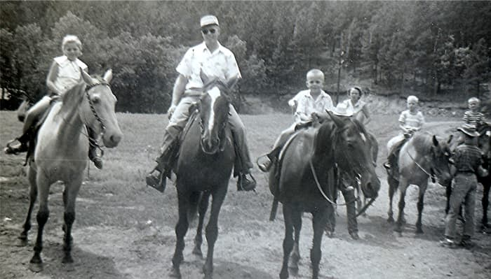 """""""Couldn't get Carol to go on the horses.  Peggy, Ralph, Johnny"""" (Riding horses at Last Frontier Game Lodge, 1950s)"""