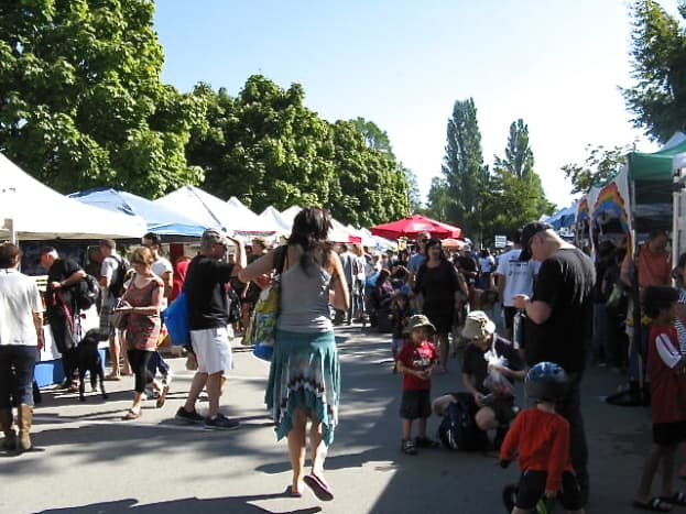 Adults, children and dogs explore the market