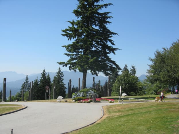 Burnaby Mountain Park with the Playground of the Gods sculpture and the North Shore Mountains in the background