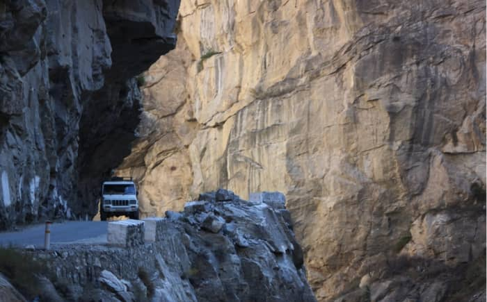 Many workers lost their lives carving tunnels through the massive rocks.