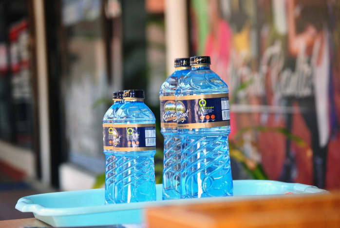 Bottled water is your best bet in Bali.  Buy lots of it and stay hydrated.