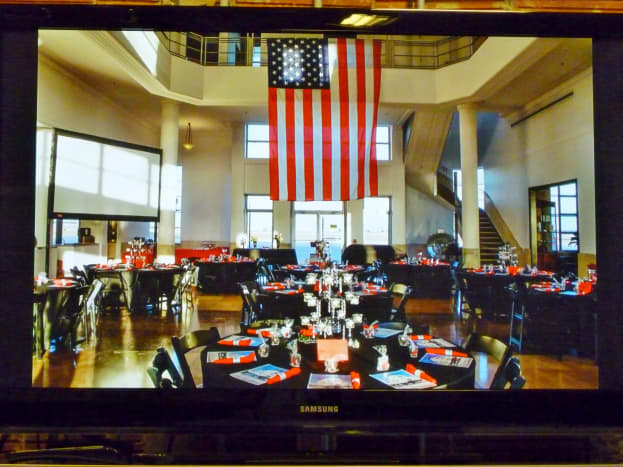 Special event captured on screen in theater at 1940 Air Terminal Museum