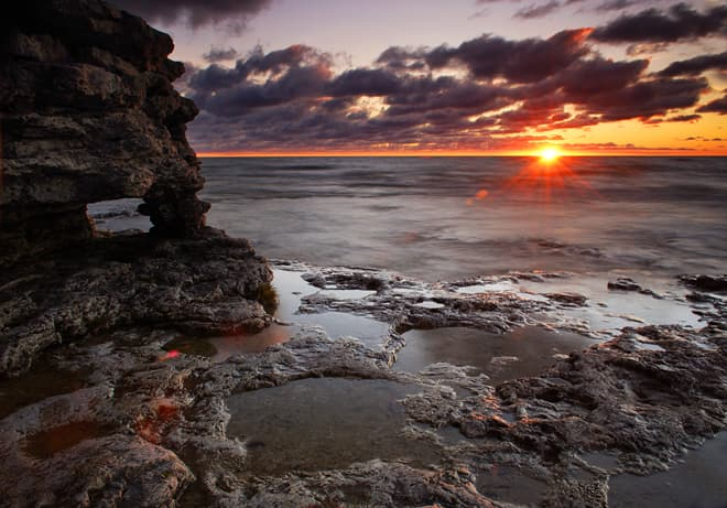 Sunrise at Cave Point near Whitefish Bay on Lake Michigan in Door County, Wisconsin