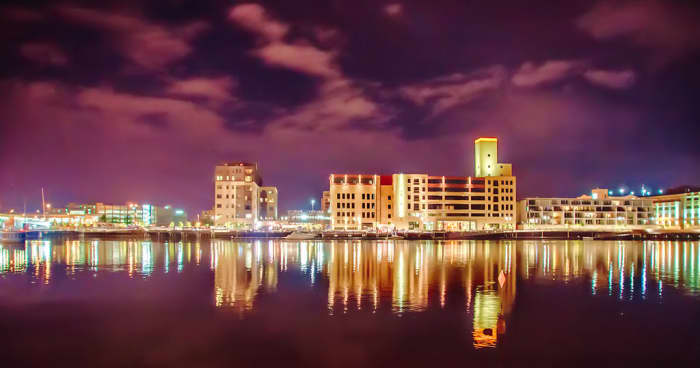 Fox River with Downtown Green Bay behind it at night - Green Bay, Wisconsin