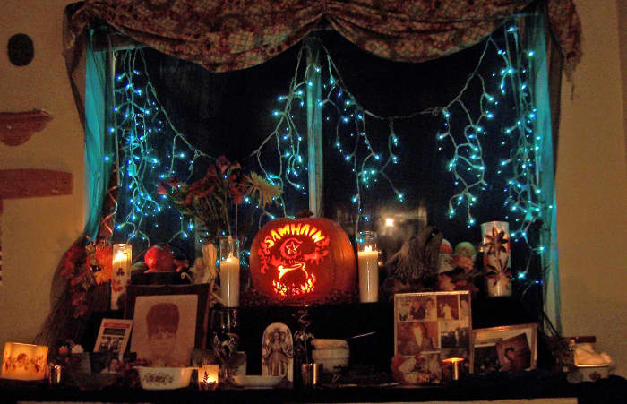 We set up in our dining room from mid-Oct to early Nov. All who come over for Samhain are welcome to add their own photos/objects/names of their dead.