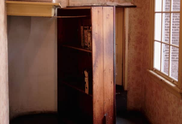 A wooden bookcase covers the hidden door in Anne Frank's house where they were hiding.