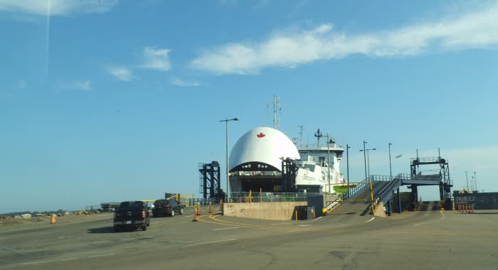 The bow raises up for the cars to drive into the ferry.