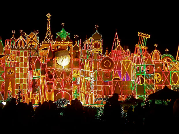 The outside of It's A Small World at night.