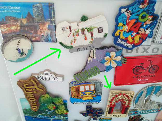 The greenish arrow points to my Olvera fridge magnet - now happily ensconced on my fridge. When traveling, it's best not to buy only very small keepsakes. Beneath the Olvera magnet is my Selville one.