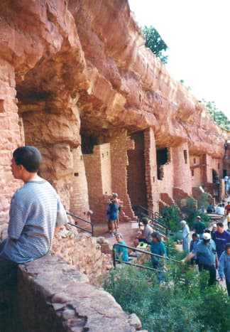 People exploring the Manitou Cliff Dwellings in Colorado