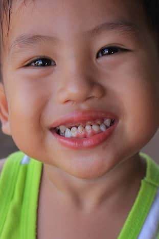 A little boy in the village shows why the nation of Thailand is sometimes known as the 'Land of Smiles'