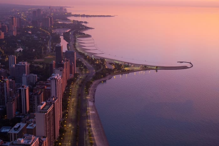 Aerial view of Lake Shore Drive in Chicago at sunrise.