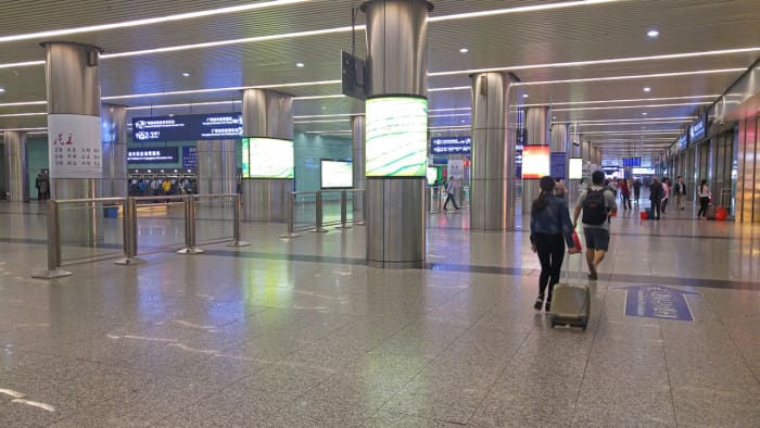 The spacious ground floor of Guangzhou East Railway Station. You need to past through security to reach this area.
