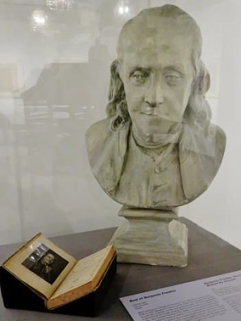Bust of Benjamin Franklin plus book written by him about his life