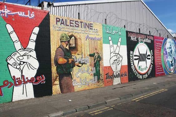 A series of murals at the International Wall in West Belfast