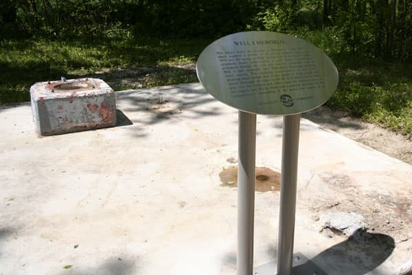 A well, which became contaminated, was permanently decommissioned and a memorial plaque erected at the site.