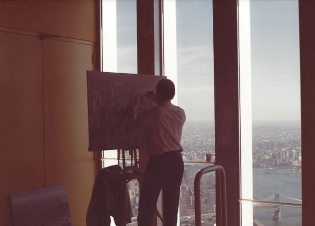 An artist painting the scene from the observation deck of the World Trade Center, New York, December 1988.