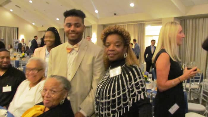 The wife of Walker along with the recipient of Walker Carter scholarship fund sponsored by PECO Energy.