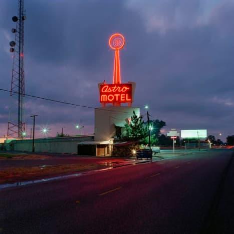 A futuristic, neon spire greets commuters