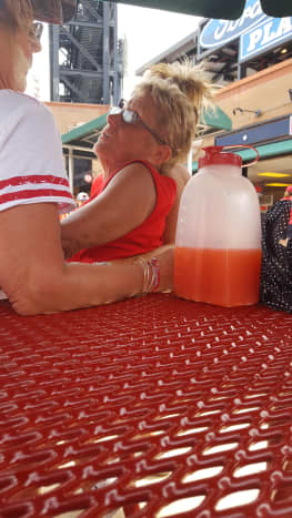 Drunk fan in red with her red juice