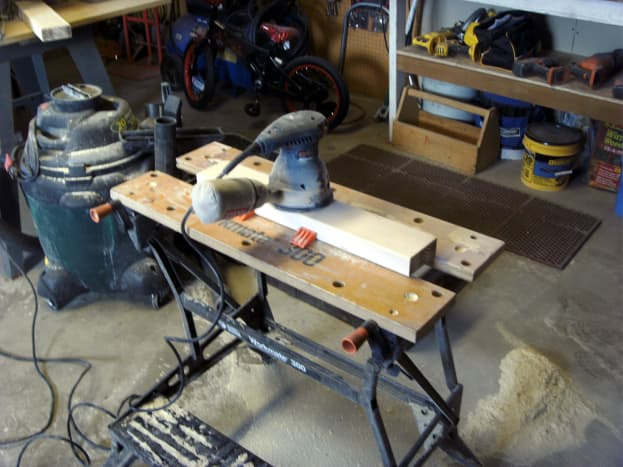 """Sanding one of the """"legs"""".  The lumber was pretty rough and needed quite a bit of work, but it ended up smooth."""