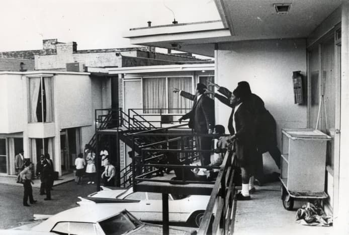 Dr. King lies mortally wounded as his aides point to where the shots rang out.