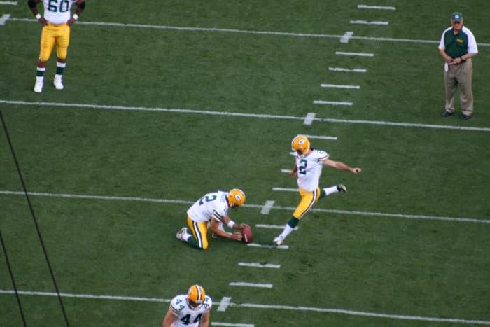 Mason Crosby practicing kicking a field goal.