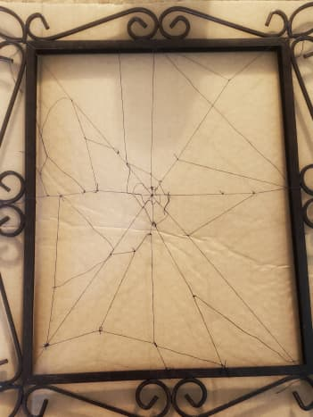 Lay your frame on a piece of cardboard.