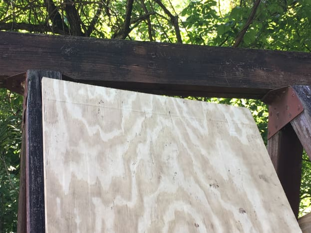 """I bought sheets of plywood for an """"A"""" shaped roof. It was big enough it didn't require cutting. Here I was lining it up but was taking pictures at the same time so it wasn't flat."""