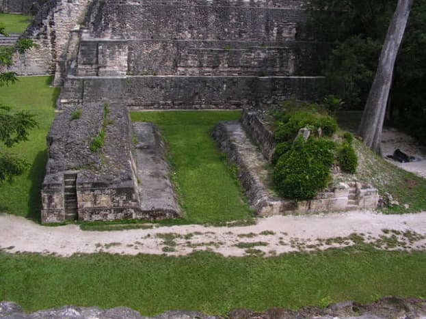 Ballcourt at Tikal, Guatemala. Mayan football in Mexico required passing a ball through this hole high on the court wall.