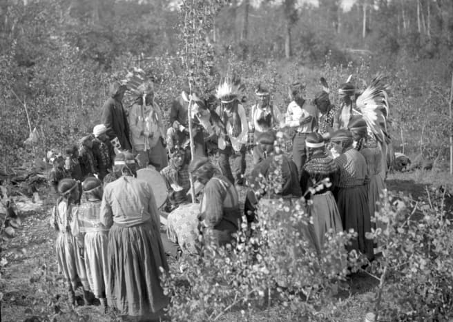 These Northern Saskatchewan Cree people are performing an outdoor ceremony near the Waterhen River in Northern Saskatchewan.