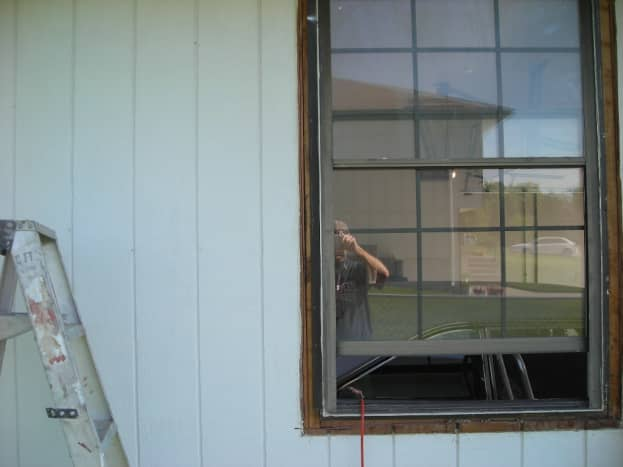 THE OLD WINDOW WITH THE SIDING CUT BACK
