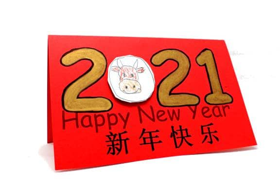 """To make this card, print it onto red paper, and color in the numbers with a gold sharpie. On a sheet of white paper, draw an ox within an oval, and paste it into the space where the """"0"""" would normally go."""