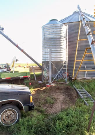 Pics of barrel reinforcements: This is a small bin used for storing grains for feeding to animals. It has a 200 bushel capacity, which is 10,000 pounds in weight when dealing with heavier grains such as wheat.